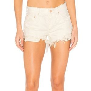 white free people shorts with embroidered detail